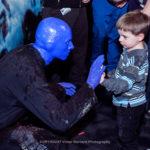 Blue Man high five a child